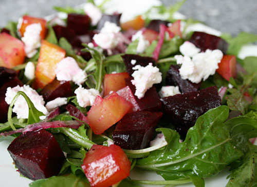 tasty salad mixing peppery arugula sweet roasted beets and goat cheese ...